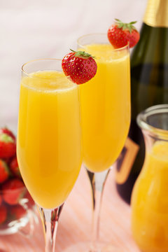 Mimosa cocktail and strawberries