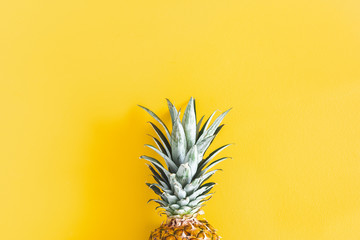 Summer composition. Pineapple on yellow background. Summer concept. Flat lay, top view