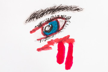 blue human eye with red tears close up