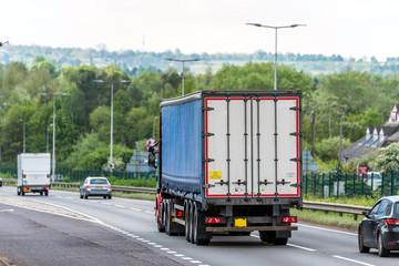 Fototapeta curtain side lorry truck on uk motorway in fast motion obraz