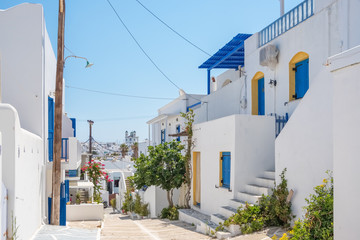 View of a beautiful white street in old town of Naoussa, Paros island, Cyclades