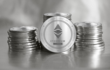 Ethereum Classic (ETC) digital crypto currency. Stack of silver coins. Cyber money.
