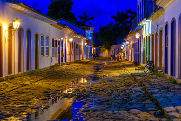 Fotomurales - Night view of street of historical center in Paraty, Rio de Janeiro, Brazil. Paraty is a preserved Portuguese colonial and Brazilian Imperial municipality