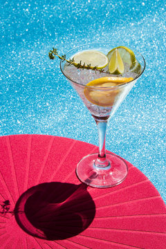 Elegant cocktail on colorful divided background. Abstract conception, art deco style