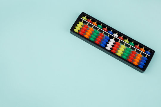 Abacus for mental arithmetic on a light blue background.