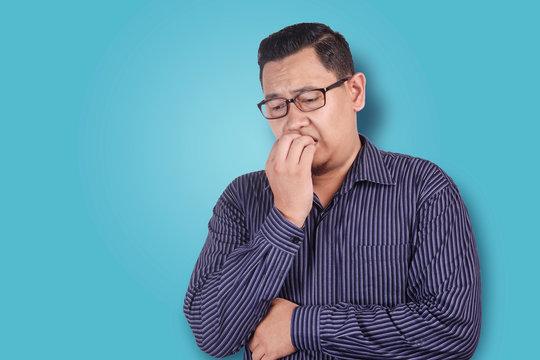 Man Worried or Nervous Expression, Biting Nails
