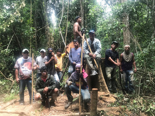 """Guardians of the forest"" fighting illegal logging pose for a photo while on patrol in the Arariboia Indigenous protected area"
