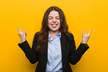 Young plus size caucasian business woman showing rock gesture with fingers