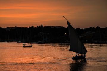 Silhouette of a Felucca sailing at sunset, Elephantine Island, Aswan, Egypt