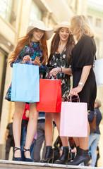 Three friends go shopping.