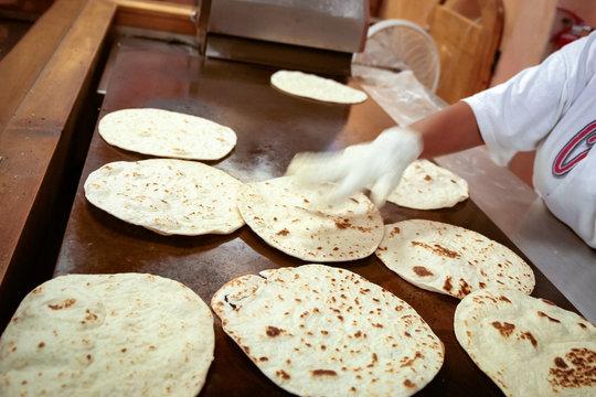 Las Vegas, New Mexico, United States.  Woman making homemade flour torillas.