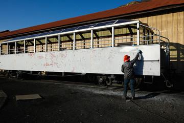 Man working on old steam train