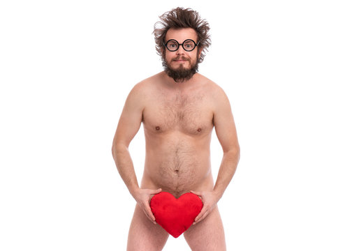 Happy Valentines Day. Crazy bearded Man with funny Haircut in eye Glasses. Happy and silly guy in Love, isolated on white background. Cheerful naked man with Red plush Heart.