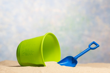 Child's Sand Bucket and Shovel Beach Scene With Copy Space