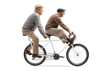 Two elderly men riding a tandem bicycle with legs up Wall mural