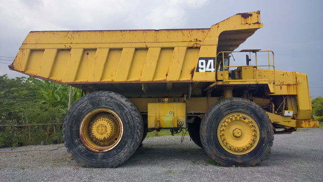 Big and heavy Yellow dump truck side view