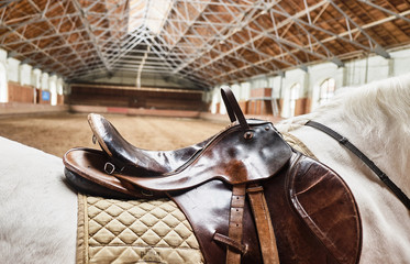 Leather horse saddle closeup. For the rider