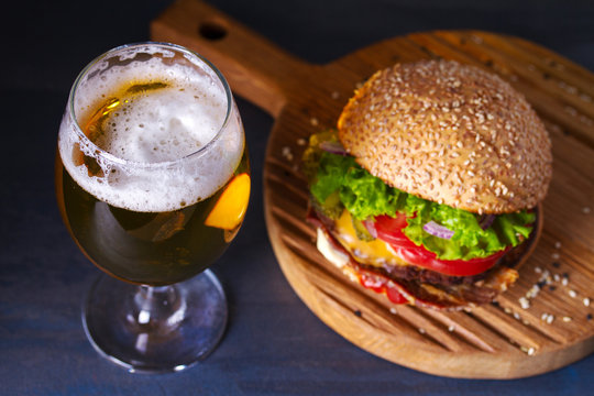 Glass of beer and burger. Beer and food concept
