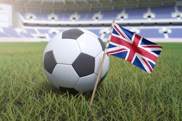 United Kingdom flag in stadium field with soccer football