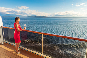 Cruise luxury travel lifestyle woman on fancy Europe vacation. Asian elegant lady drinking...