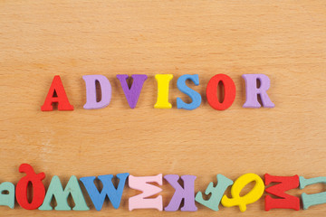 ADVISOR word on wooden background composed from colorful abc alphabet block wooden letters, copy space for ad text. Learning english concept.
