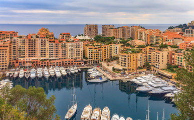 Marina in Monaco Ville with luxury yachts and apartments in harbor of Monaco, Cote d'Azur or the French Riviera
