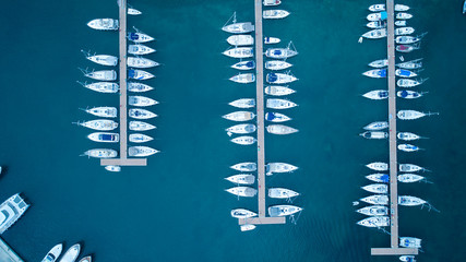Fototapeta Aerial view of yachts and boat berthed in the marina and clear water. Aerial view of the Marina in Turkey. Holiday icons .