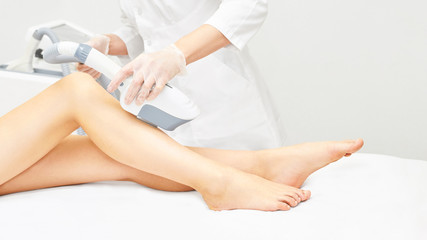 Laser ipl device in doctor hand. Woman body hair removal. Perfect epilator. Cosmetology leg technology