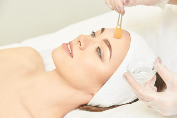 Facial brush peel retinol treatment. Beauty woman peeling procedure. Cosmetology young girl therapy.Hyaluronic acid