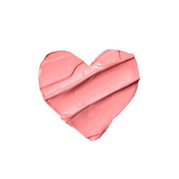 Heart from liquid pink lipstick isolated on white background