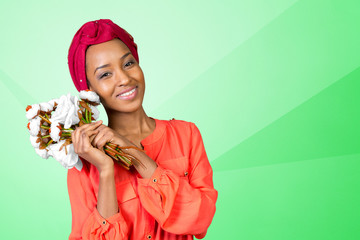 African American woman smiling with bouquet of flowers