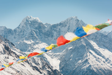Fotobehang Nepal Everest trekking and hiking. Mountains of Nepal. Mountain in focus. Nepalese prayer flags are blurred. Adventure in the Himalayas