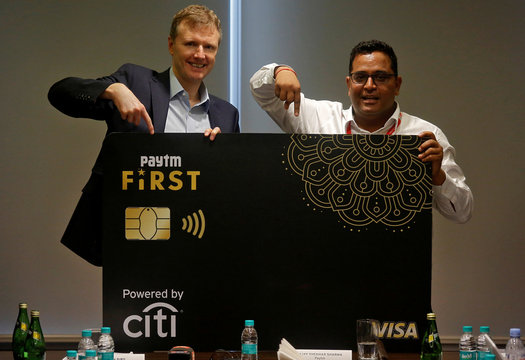 Vijay Shekhar Sharma and Stephen Bird gesture as they launch a Citibank and Paytm credit card in Mumbai