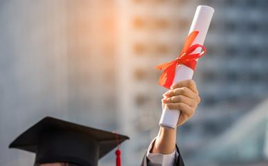 graduation certificate in her hand