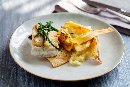Sea bass fillet with parsnip crisp and samphire