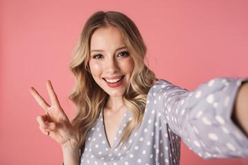 Beautiful young blonde woman wearing summer dress Wall mural