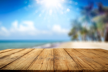 Desk of free space and summer background of beach with palms and summer sea