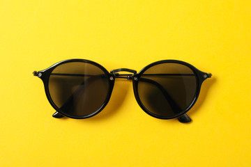 Sunglasses on color background, space for text and closeup. Fashionable accessories