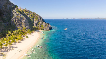Fotobehang Duiken White sand beach near the rocks and boats.Palawan,Busuanga,Tropical beach for tourists aerial view