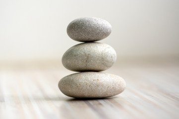Harmony and balance, cairns, simple poise stones on wooden light white gray background, simplicity rock zen sculpture Fototapete