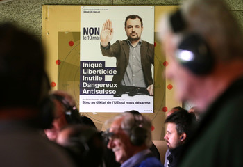 A poster asking people to vote no is pictured during the Fribourg County 300m rifle final at the shooting range in Romont