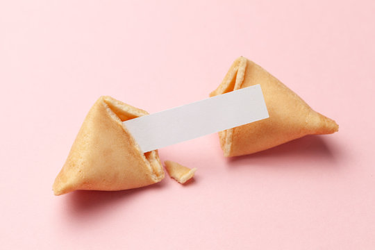 Chinese fortune cookies. Cookies with empty blank inside for prediction words. Pink background.
