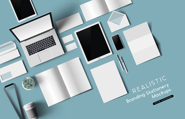 Top down view of office desk realistic stationery and objects. Vector mockup illustration.
