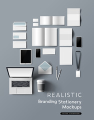 A realistic and detailed collection of business office branding and identity stationery mockups, with smartphones, tablet, notebook and brochures. Vector illustration.