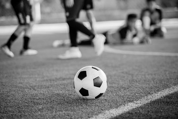 Black and white picture of Soccer ball on artificial turf