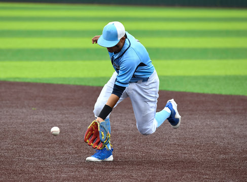 Young athletic boys playing sport of baseball