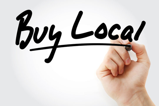 Buy Local text with marker, business concept background