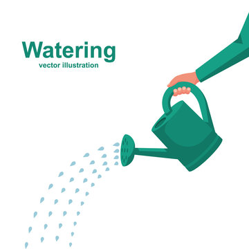 Watering can holding in hand