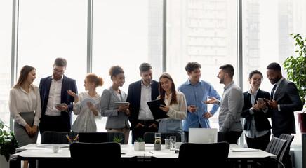 Business team having break, standing near window