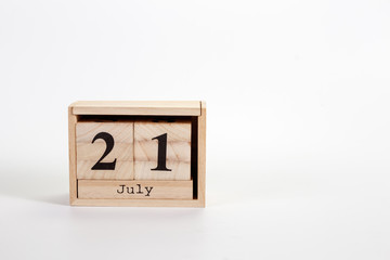 Wooden calendar July 21 on a white background